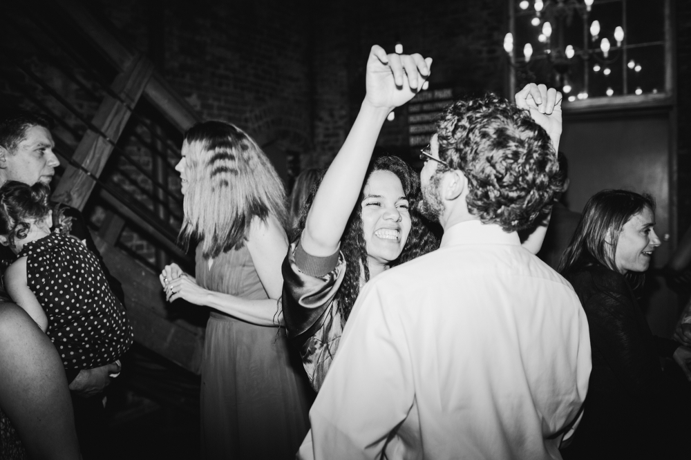 This is a photo of guests dancing at the wedding.