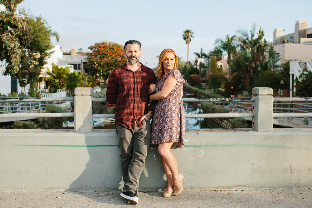 Max and Drew near a green wall.