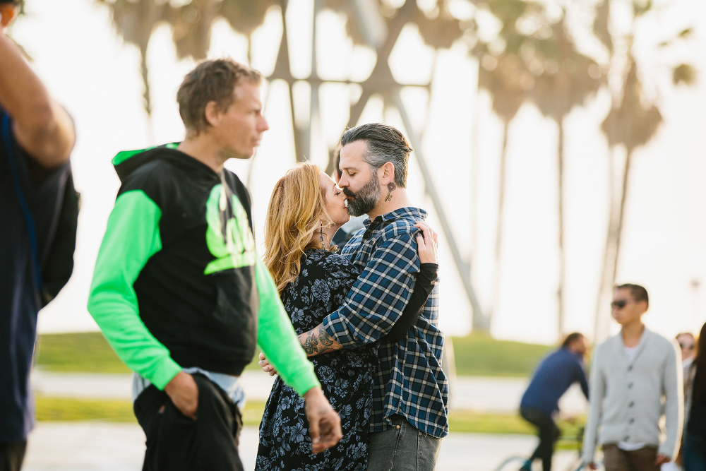 People walking around the couple.
