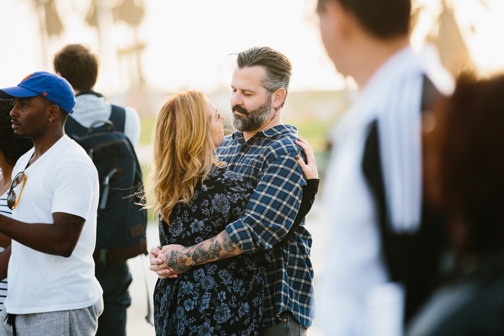 Max and Drew surrounded by people.
