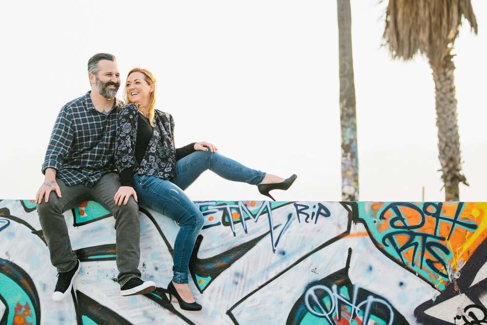 The couple sitting on a wall.