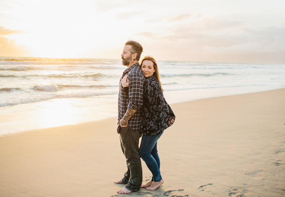 Max hugging Drew from behind.