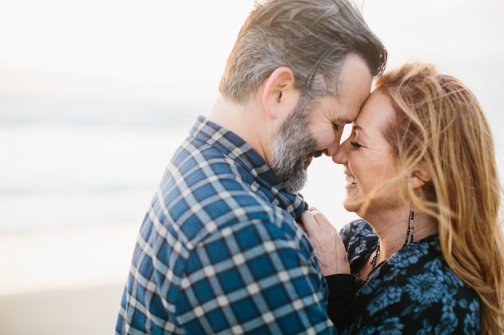 The couple laughing together.