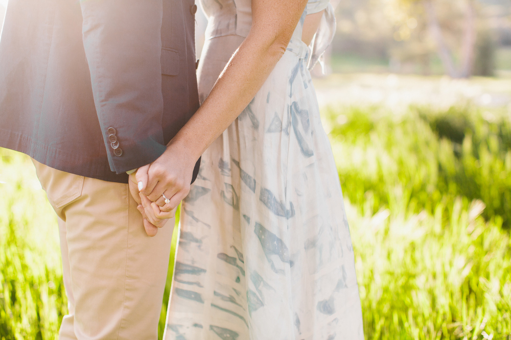 Kara and Sean holding hands.