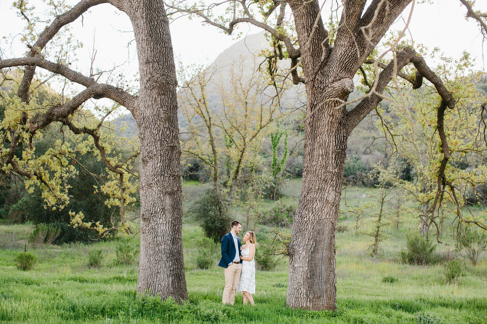 The couple between two trees.