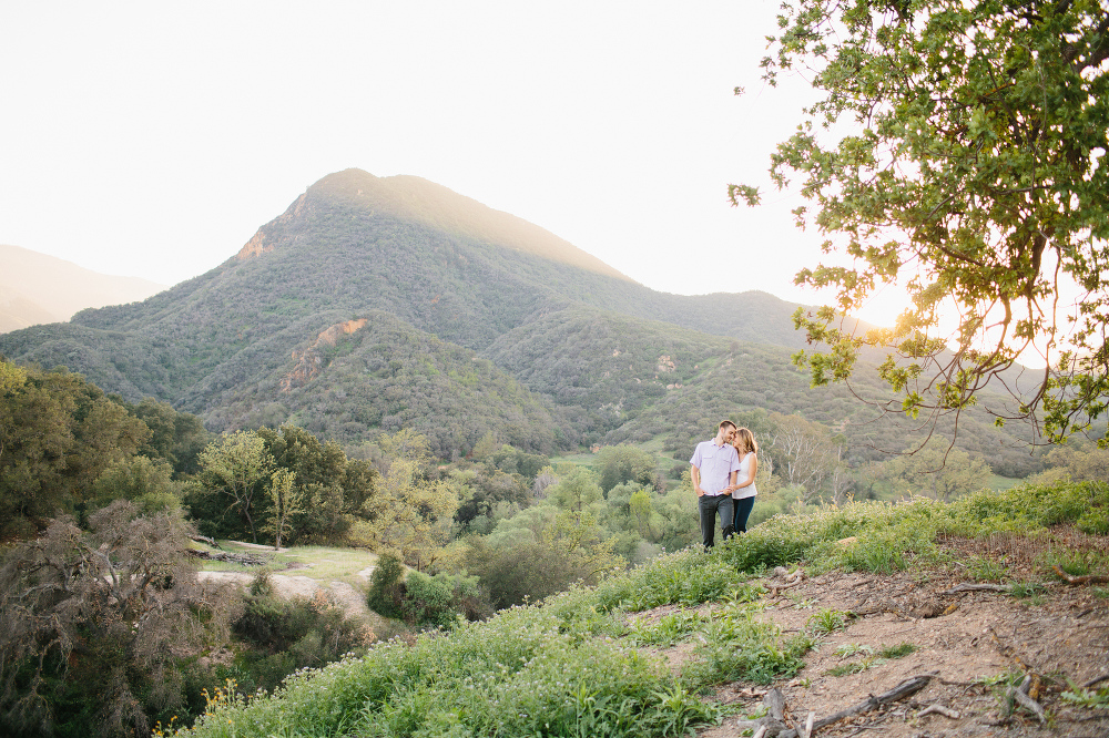 The couple with mountains in the background.