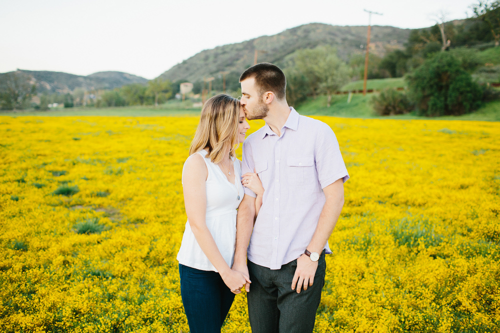 The couple surrounded by yellow flowers.